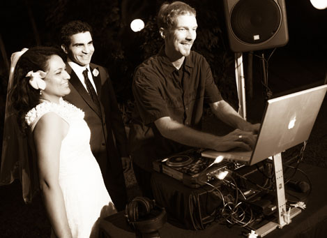 DJ Adian Blackhurst with the wedding couple