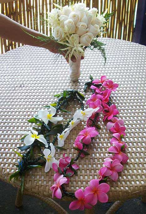 Traditional wedding leis for the bride & groom by Nui