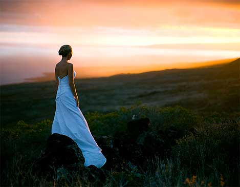 Bride at sunset overlooking Maui