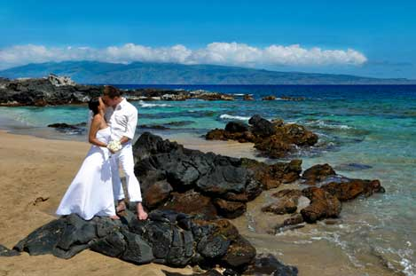 Bride & Groom on lava at the beach