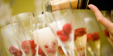 Pouring Champagne with Cherries