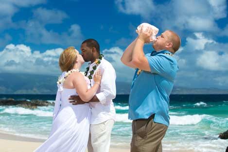 Beach wedding ceremony conch blowing