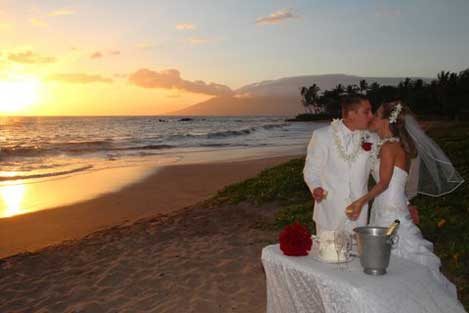 Beach wedding with cake & champagne