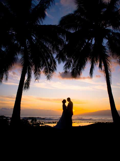 Couple at sunset with a Royal Affair Wedding