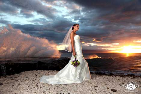 Bride on the beach by Natalie Brown